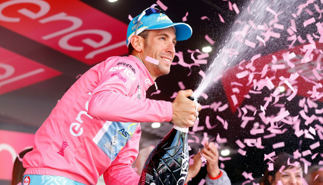 Vincenzo Nibali celebrates the pink jersey on the podium of the 20th stage of the Giro d'Italia.